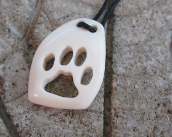 SALE Cat paw print carved bone pendant / carved tribal pendant / Hand carved paw print pendant