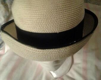 Vintage white sailor hat/black trim/black bow. An exclusive Lisa New York.