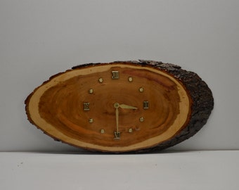 Hand cut Wild Cherry wood clock sealed in clearcast epoxy