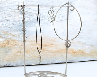 Water Leaf Jewelry Stand by Marsh Scott. Stainless steel.