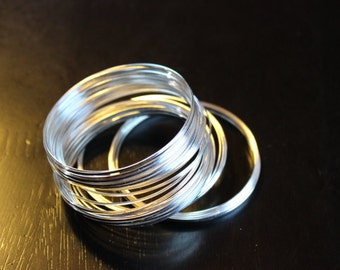 50 circles of memory wire, sold in 2-3 pieces to make the 50 circles, flat wire, 1.2 x 0.5 mm wire, 55 mm diameter, silver