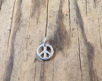 OVERSTOCK SALE  Tiny Sterling silver peace charm. Add a charm to your mala tassel