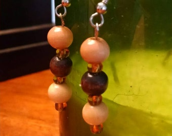 Wooden bead earrings with gold accents.