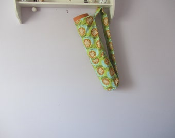Yoga mat carrier with wide arm strap and three outside pockets.