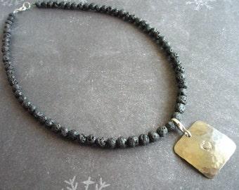 Lava necklace with square titanium charm.
