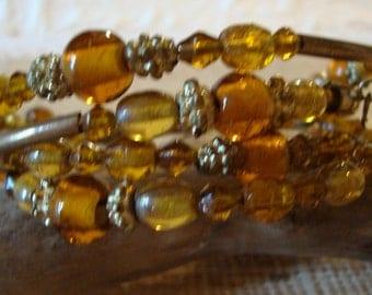 Vintage Cognac Amber Lucite Beaded Women Snake Bralelet