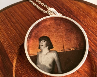 Surreal collage pendant
