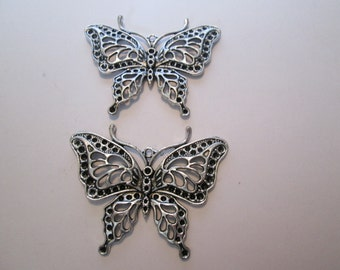 Silver filagree butterfly pendant/charm 2 for 1 dollar