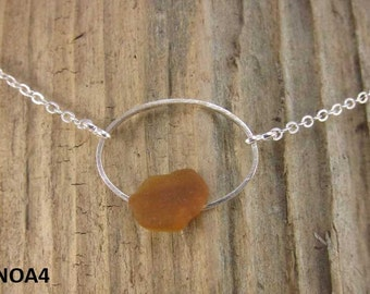 Necklace with brown Nova Scotia sea glass mounted on silverplate oval with silverplate chain (NOA4))