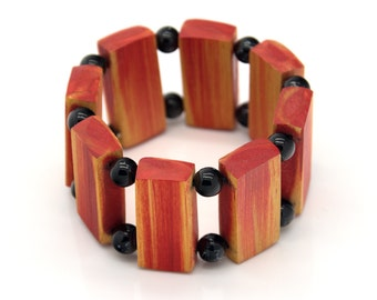 "Wooden bracelet. Reclaimed wood. Recycled. Jewelry. Eco friendly. Elastic bracelet. Stretch. Size: 6 1/2"" (16.5 cm)"