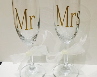 Mr and Mrs toasting flutes