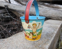 Vintage Beach Pops Candy Child's Tin Litho Sand Pail – Vintage Tin Toy - Sand Bucket - Candy Container - Beach Toy - 1940's – E. Rosen Co.