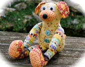 Whimsical Stuffed Toy Dog Brightly Colored Plush Toy Dog Orange Polka Dots Flower Ears Purple Blue and Yellow Striped Stuffed Plush Toy Dog