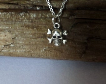 Men's silver chain with a silver toned skull and bones charm