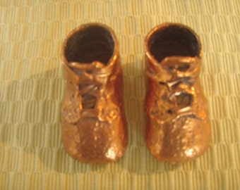 Vintage copper baby shoes from the 1950s.