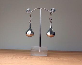 Long, shiny metallic silver teardrop earrings