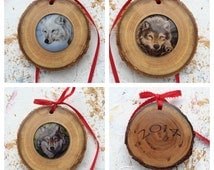 wood and art glass wolf ornaments. White wolf and gray wolf