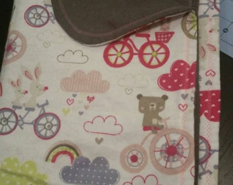 Cute bears and bicycles print receiving blanket with grey back side.