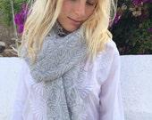 Cosy merino wool shawl in light grey leaves print