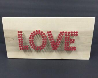 Wooden love nail sign.