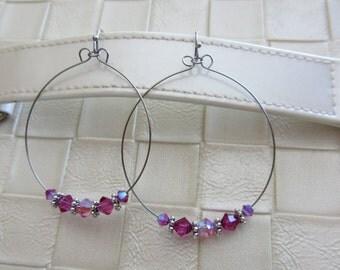 Swarovski Crystal hoop earrings, fuchsia, pink, with silver spacers