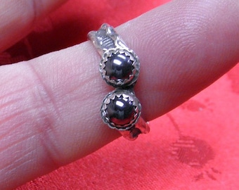 This ring has 2 -  5 mm  Hematite stones in it..The ring is size 7 3/4