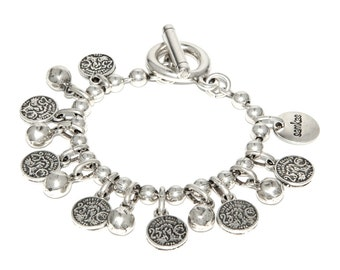 Silver bracelet with vintage look coins. Handcrafted in Spain. Samkas Timeless Collection.