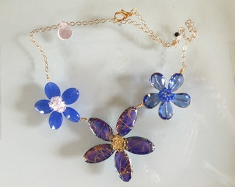 Blue shell flower necklace with 14 karat gold filled chain.