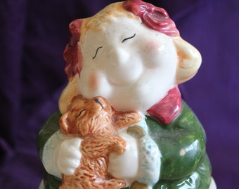 Vintage Old and Chubby Lady Holding a Dog Piggy Bank by WCL