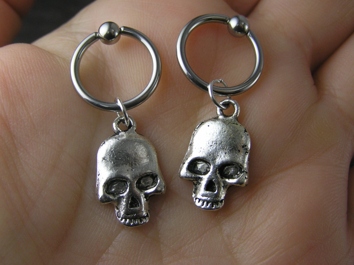 captive bead earrings one silver skull captive bead ring earring 12g 14g 16g 18g 2787