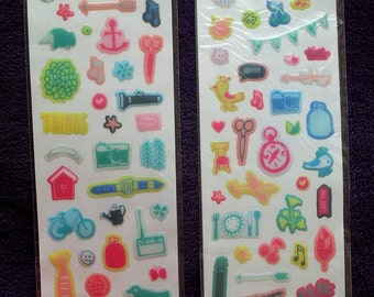Two sheets of colorful stickers