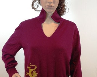 Maroon merino wool v-neck collared sweater embroidered with a gold dragon design. Size Large