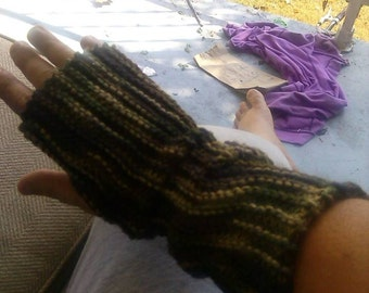 These are long knitted fingerless gloves that are made to order