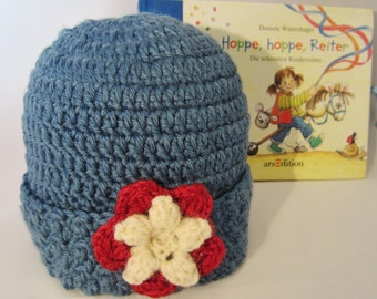 Hat - Girls, the hat is hand crochet in a medium acrylic blue yarn & embellised with a wine colored flower with a white center. Lovely  gift