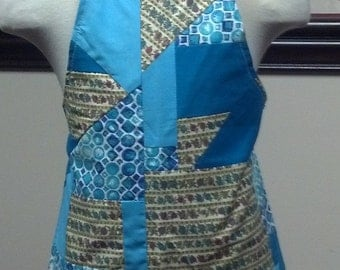 Crazy pieced blue and brown cotton child's apron fully lined