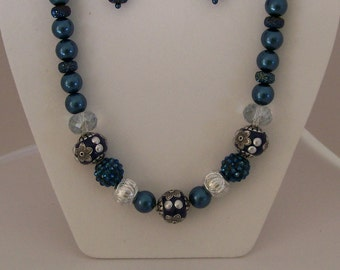 Navy Blue Pearl Bead Necklace, bracelet, and earrings with glitzy and shiny bead accents.