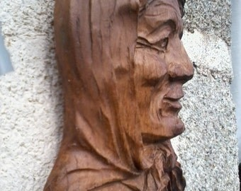 Old woman carved in wood