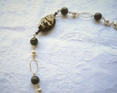 Fire agate bracelet with black beads, brown Swarovski bicones and sterling silver links. Brown bracelet. Semiprecious stone.