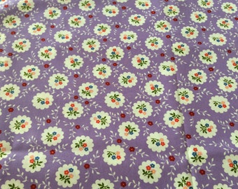 100 % cotton floral fabric suitable for quilting.