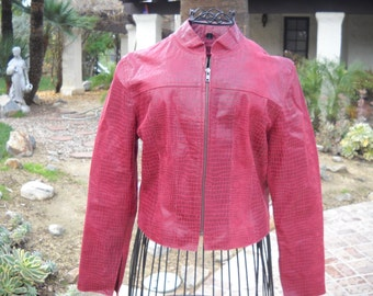Red Leather and Suede Snakeskin look XOXO Jacket from Nordstroms. Size Small. Valetines day.Zips up the front. Light weight great 4 outings.