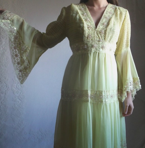 https://www.etsy.com/listing/221614275/60s-yellow-hippie-dress-vintage-bell?ref=favs_view_7