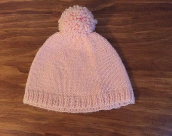 Vintage knit baby winter hat with pom pom in soft pink