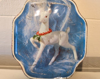 1950s vintage tin with a white fawn / deer on the front