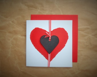 """White card with red """"torn"""" paper heart motif & chalkboard heart."""