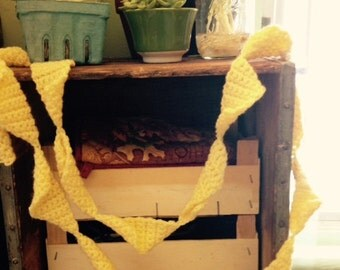 Yellow knitted yarn garland