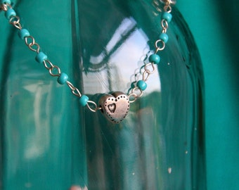 Delicate silver bracelet with a silver heart and blue beads