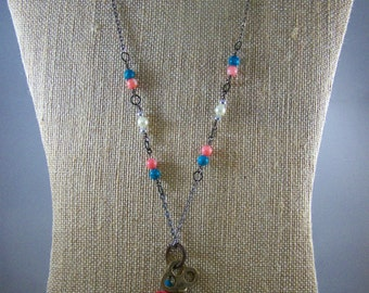 Handmade necklace created from vintage skeleton key and beads