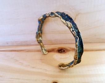 Bronze with patina bracelet.
