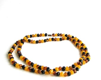 amber yellow and black beaded necklace . long bead strand necklace . vintage bead necklace