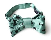 "Chill Pill bow tie. Capsule & tablet silkscreen print.""Pill Spill."" Perfect for doctors and pharmacists. By Cyberoptix Tie Lab."